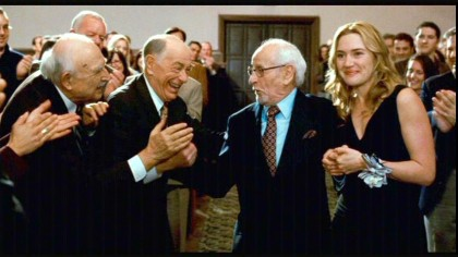 In this scene, SHELLEY BERMAN is the second from the left and ELI WALLACH is next to Kate Winslet