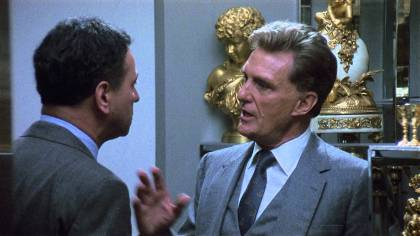 ALAN ARKIN and ROBERT STACK, who plays the head of the insurance firm that employs Leonard Hoffman.