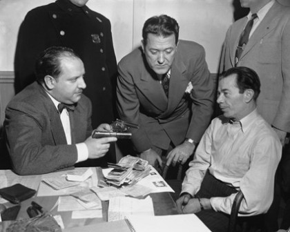 Willie Sutton, right, is questioned after his arrest in Brooklyn in 1952.