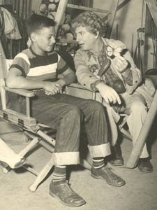 BILL and HARPO MARX on a movie set.